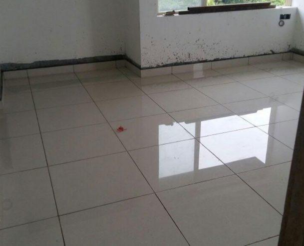 Floor tiling (inside flats) in progress (Sept 2016)
